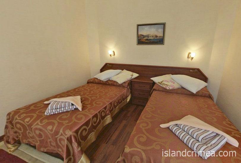 """Отель """"Русское море"""", номер люкс, спальня"""
