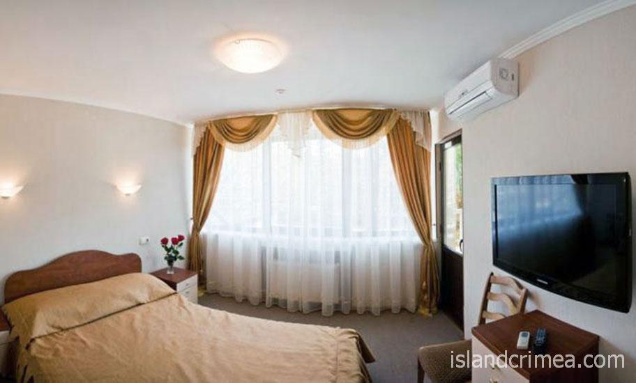 """Санаторий """"Золотой колос"""", спальня в номере Junior suite."""